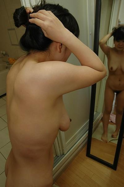 Asian MILF with flabby jugs and hairy cunt Miyuki Miyaji taking shower