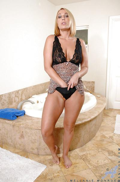 Stunning hottie Mellanie Monroe making her pussy wet and aroused in the shower