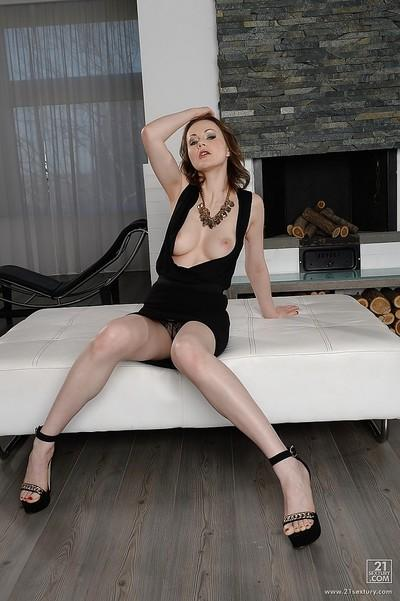 Undressing European milf Tina Kay caught on camera in her living room