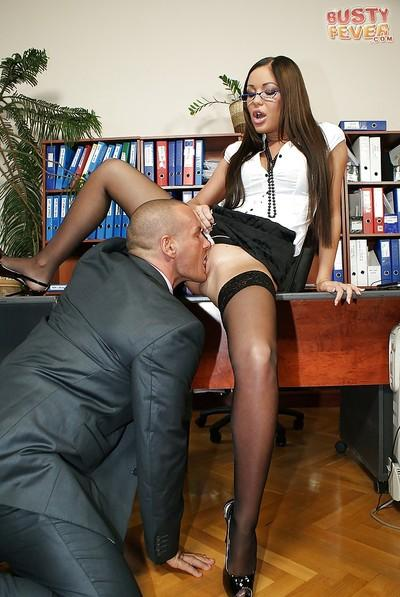 European brunette in black stockings is fucked while in the library