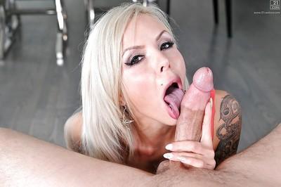Platinum blonde pornstar Nina Elle licking big cock and balls
