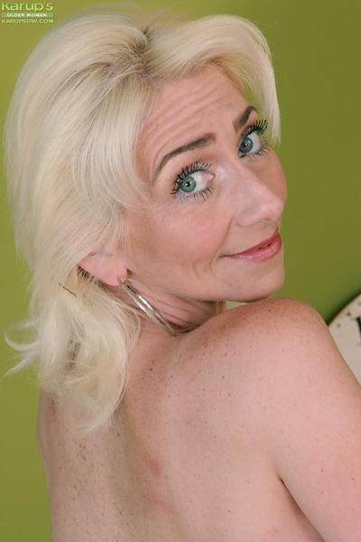 Skinny granny Janotova undressing for masturbation of shaved cunt