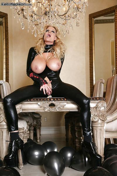 Milf slut Kelly Madison is showing off in her sexy latex outfit