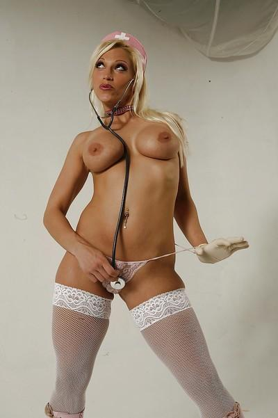 Hot nurse Nicki Hunter stripping off her latex uniform and lingerie