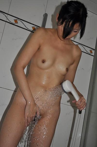 Svelte asian MILF with small titties Mayu Yamano taking bath