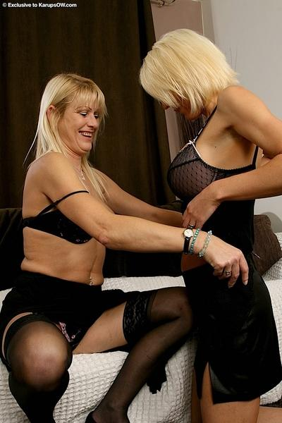 Horny blonde MILFs with big tits make some sensuous lesbian action