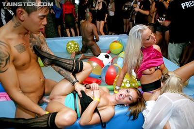 Stupendous sluts with hot bodies enjoy a wild interracial pool orgy