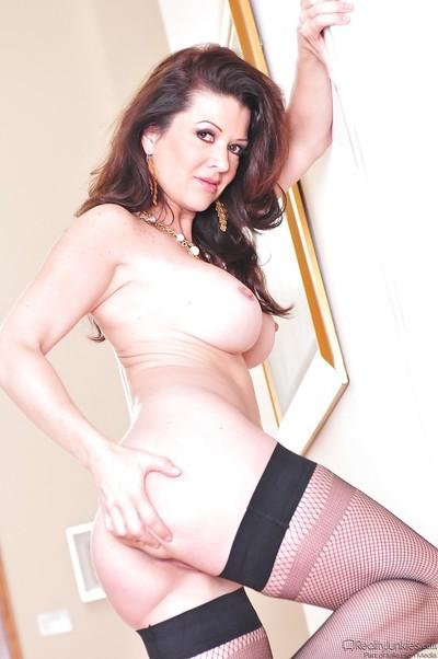 Good-looking milf in sexy stockings Raquel Devine takes nice position