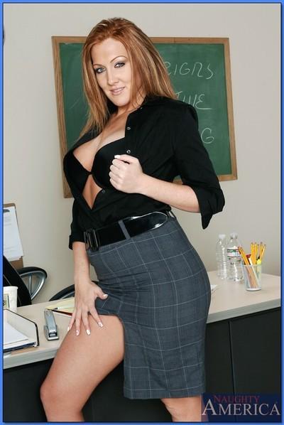 Redheaded MILF teacher Morgan Reigns masturbating on her desk