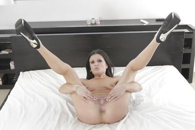 Hot brunette MILF Soraya Rico flashing small boobs and spreading pussy