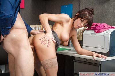 Office brunette Rahyndee James sucks a nice prick in close-up