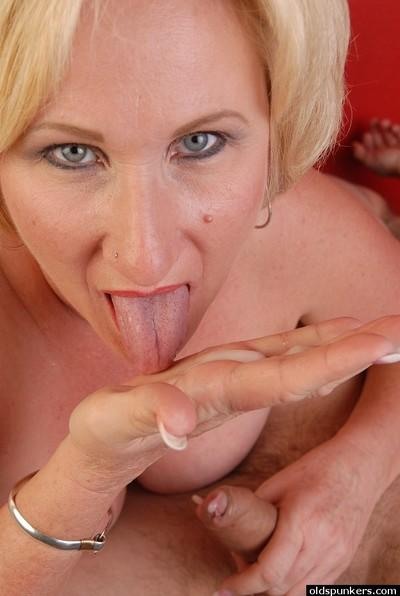 Stunning mature Molly is sucking white jizz from her palm on cam