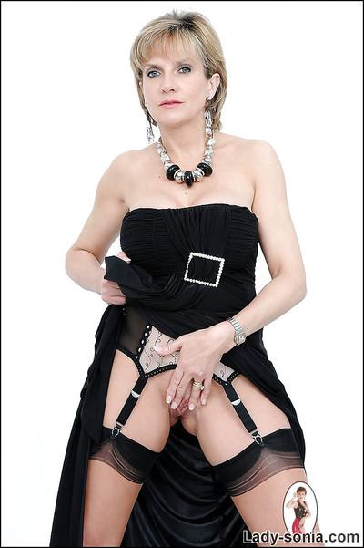 Fetish mature babe with huge tits has no panties under her black dress