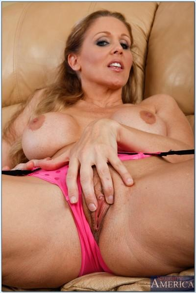 Big tits mature Julia Ann in stockings spreading legs and masturbating