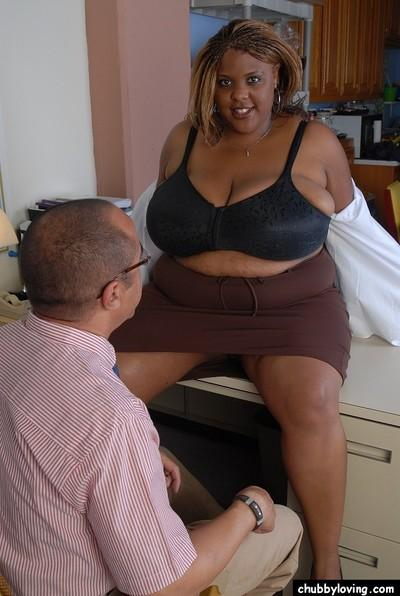 Chesty black fatty Minxx taking cumshot on massive black breasts