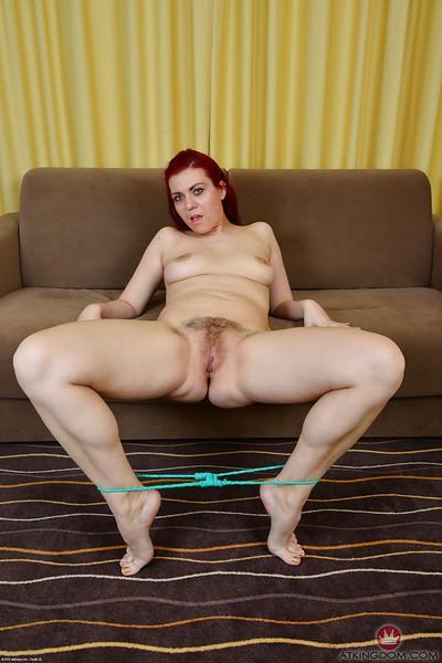 Older redhead model Corazon De Angel posing topless in pantyhose