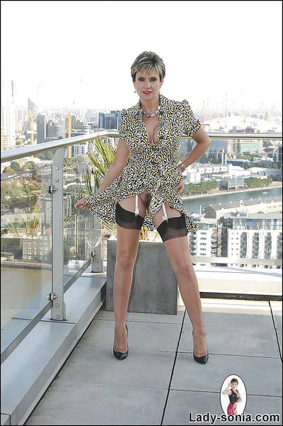 Gorgeous mature lady in nylon stockings doing upskirt outdoor