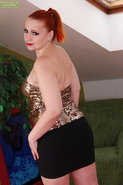 Older redhead Svitokova bares chunky butt and and spreads aged twat