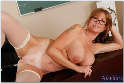 Mature teacher in glasses Darla Crane stripping and spreading her legs
