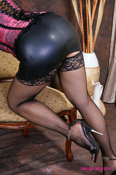 Lubricious mature Roni posing in fishnet stockings and sexy lingerie