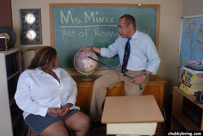 Chesty black schoolteacher Minxx revealing fat black boobs in classroom