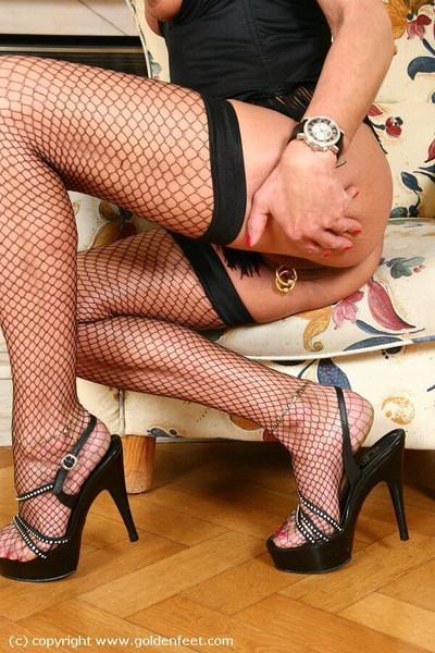 Older UK broad Lady Sarah posing solo in high heels and fishnet stockings