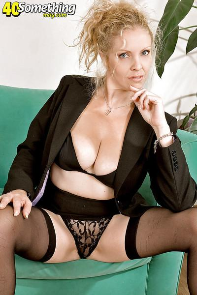 Hot mom in black nylon stockings and hold-ups demonstrating her nude beauty