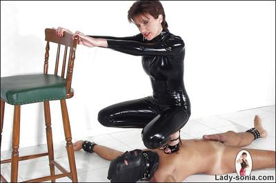 Curvy mature lady in latex outfit is into hot femdom action