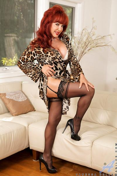 Redhead mature lassie in leopard dress undressing and exposing her twat