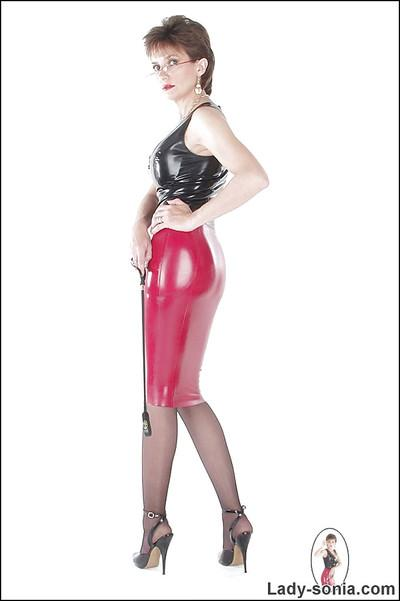 Lusty mature fetish lady posing in provocative latex outfit