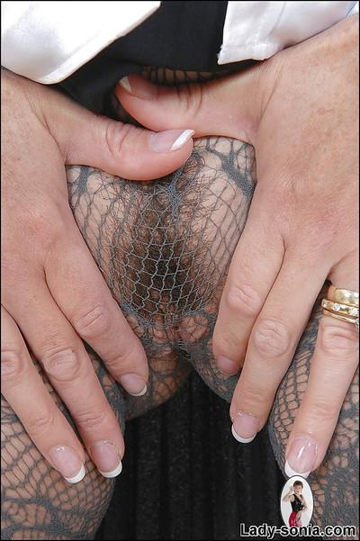 Hot mature lady with no panties under lacy pantyhose doing upskirt