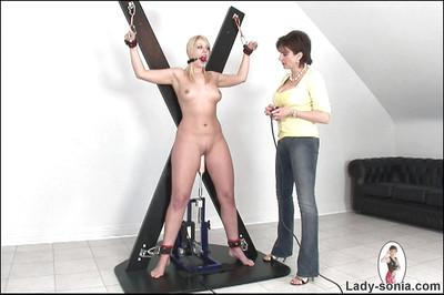 Ballgagged mature gal gets involved into BDSM action with fucking machine