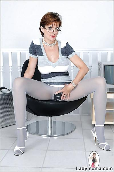 Sexy mature lady in pantyhose flashing her petite round tits
