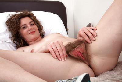 Mature European babe Sofia Matthews pets her wonderful hairy cunt