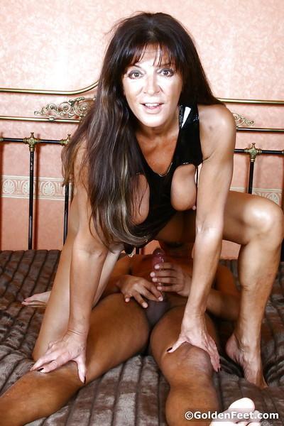 Mature fetish and BDSM model Lady Sarah baring pierced vagina