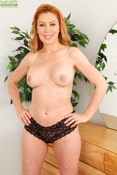 Older redhead Sasha Sean shows off her nice set of mature woman tits