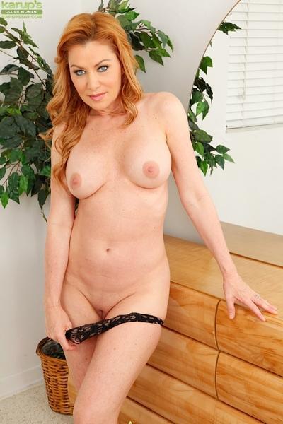 Older redhead Sasha Sean shows off her nice set of mature woman tits