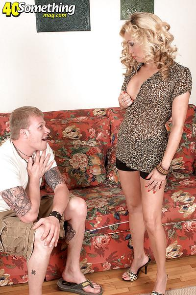 Busty mature in shorts craves to be stuffed with  hard dick of a younger guy