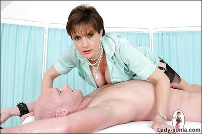 Mature femdom in stockings teasing and torturing her male pet