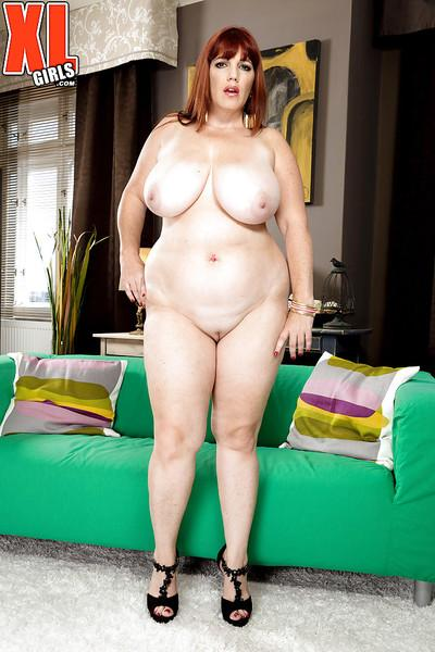 Chunky older redhead Roxee Robinson exposing huge natural tits in lingerie