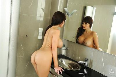 Voluptuous brunette Aletta Ocean fingering her cunt in the shower