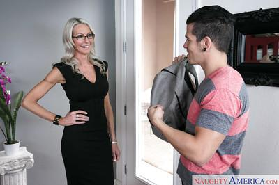 Mature blonde teacher Emma Starr sucks and fucks her horny student