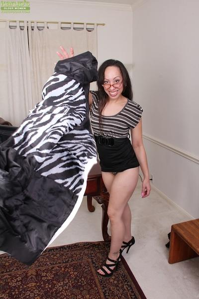 Experienced Latina lady Sasha Soja posing in skirt and glasses