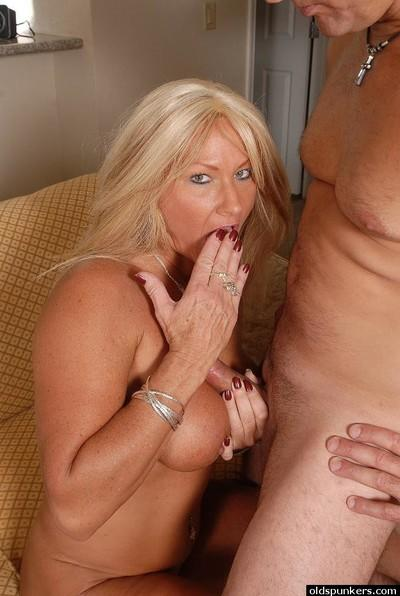 Incredible blonde mature Roxy gagging on a young stud