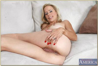 Sexy mature blonde Payton Leigh spreads shaved cunt and poses in heels