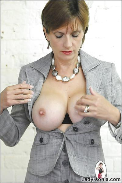 Filthy mature lady in stockings exposing her big tits with hard nipples