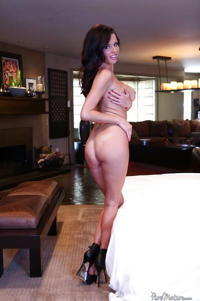 Mature brunette Veronica Avluv poses on her black high heels