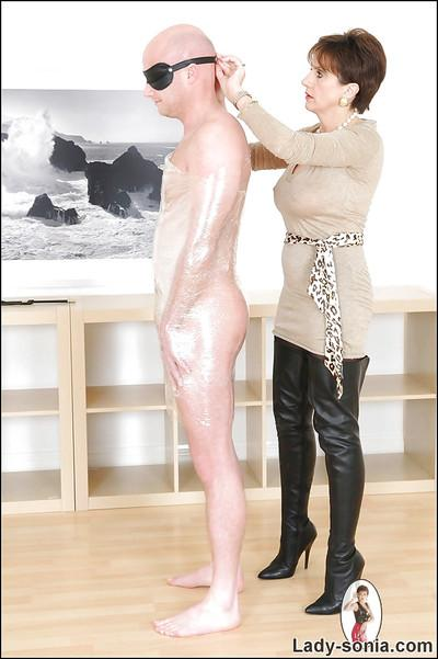 Kinky mature femdom in high-heeled boots has some fun with her human pet