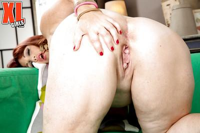 Mature redheaded fatty Roxee Robinson unveiling huge juggs and big booty