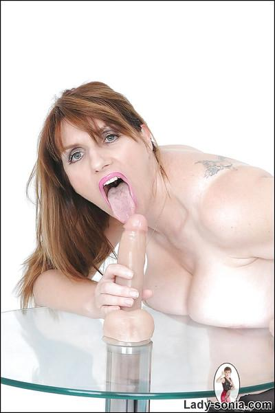 Mature bombshell shows off her titjob and cock sucking skills using a dildo